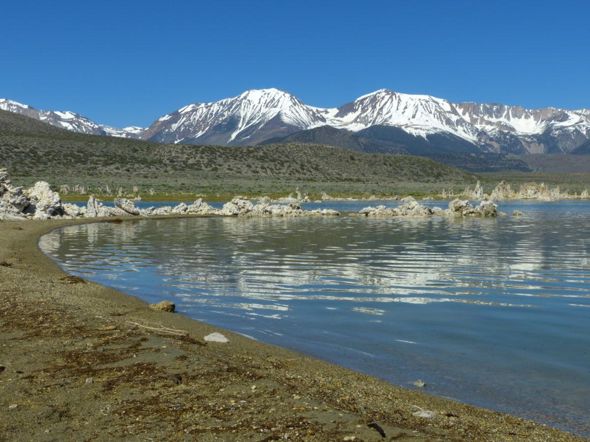 Reflection of Eastern Sierra Nevada peaks in Mono Lake  -  South Tufa Area  -  Mono Basin National Forest Scenic Area, California
